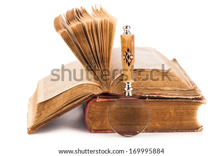 magnifying glass and old law books