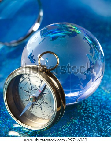Magnifying glass, Compass and globe - stock photo