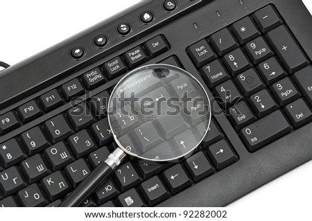 Magnifying glass, concept of on line security and investigation - stock photo