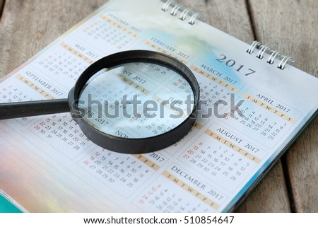 magnifying glass. in calendar.