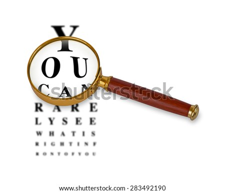 Magnifying glass in front of a funny eyetest chart. Eyetest in background is blurred while vision through magnifying glass lens is sharp. Magnifying glass has golden rim and wooden handle.  - stock photo