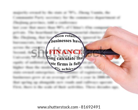 Magnifying glass in hand and word finance