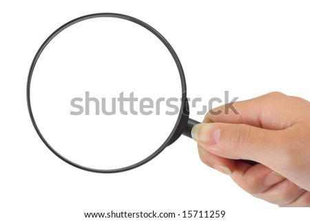Magnifying glass in woman hand isolated on white background - stock photo