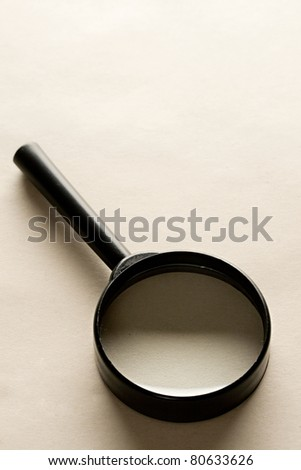 Magnifying glass isolated on the paper background. - stock photo