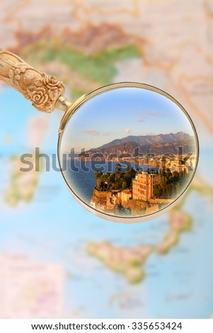 Magnifying glass looking in on Sorrento, Italy at sunset - stock photo