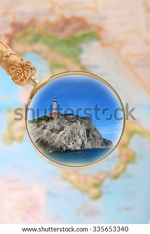 Magnifying glass looking in on the lighthouse in Capri, Italy - stock photo