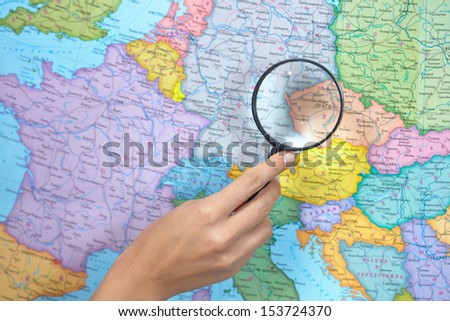 Magnifying Glass on a Map - stock photo