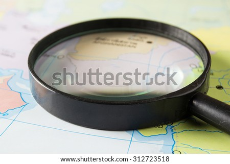 magnifying glass on a map - close-up