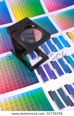 Magnifying Glass on Color Swatches Series - stock photo