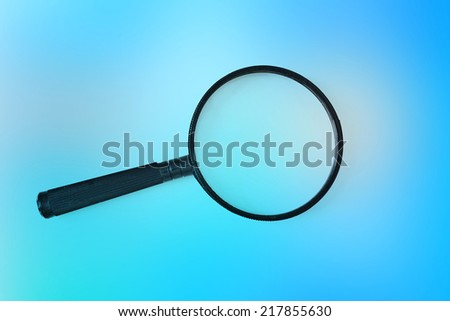 magnifying glass on colored background  - stock photo
