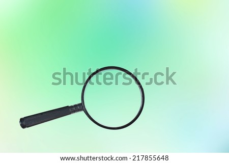 magnifying glass on colored background