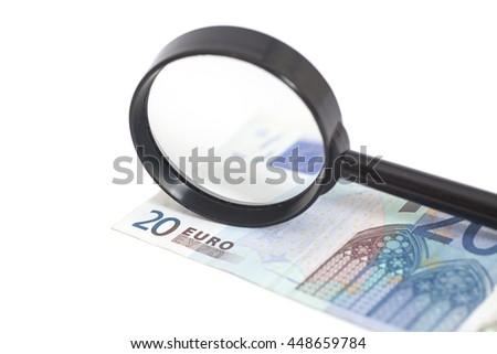 Magnifying Glass On 20 Euros isolated on white - stock photo