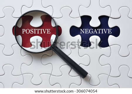 """Magnifying Glass On Missing Puzzle with """"POSITIVE/NEGATIVE"""" Word, Antonym Concept and Selective Focus - stock photo"""