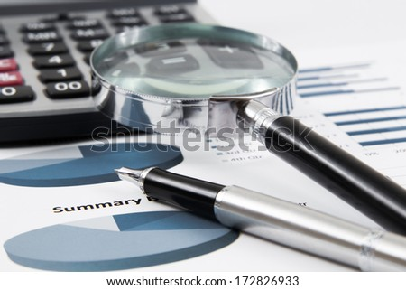 magnifying glass on the business report. Accounting