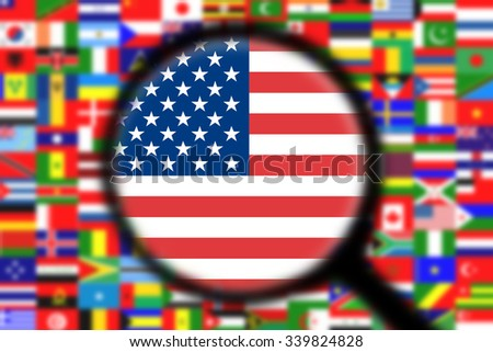 Magnifying glass on the flag of the United States of America (USA)