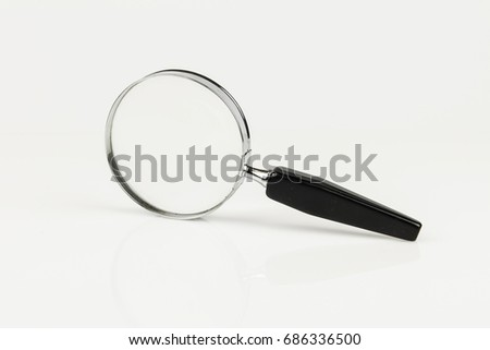 Magnifying glass on the side.