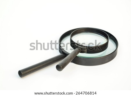 Magnifying glass on white background. - stock photo