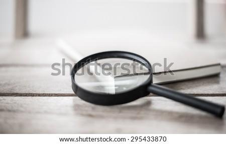 Magnifying Glass on white&black  - stock photo
