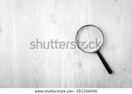 Magnifying glass on wood background, Search symbol - stock photo