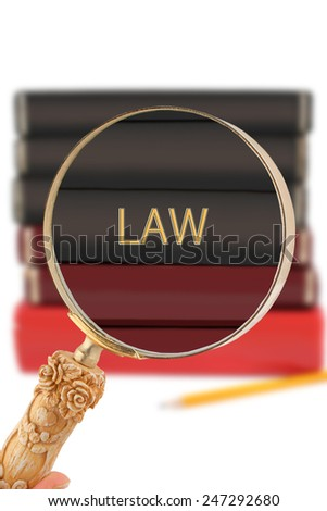 Magnifying glass or loop looking on an educational university subject - Law - stock photo