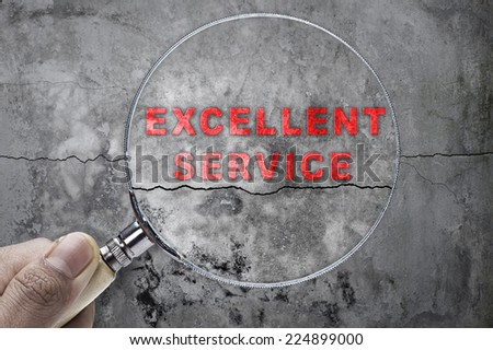 "Magnifying glass searching ""GOALS"" over cracked wall as a background - stock photo"