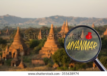 """Magnifying glass searching """"MYANMAR""""  with Myanmar blur background - stock photo"""