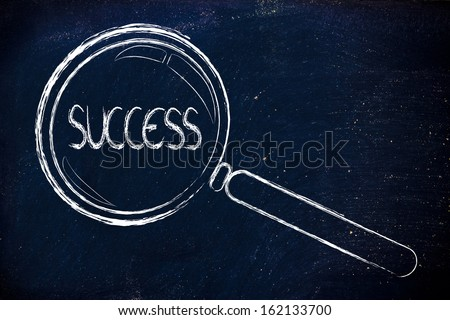 magnifying glass seeking success in business - stock photo