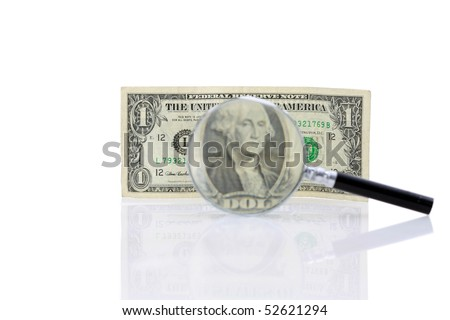 magnifying glass with a close up of a one dollar bill isolated on white - stock photo