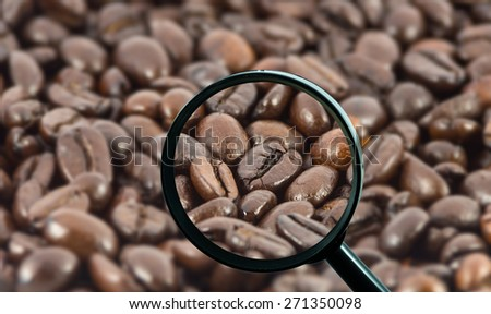 magnifying glass with background of roasted coffee beans, food and drink with business concept - stock photo