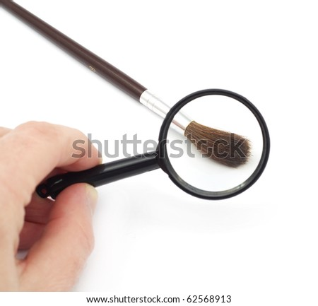 magnifying glass with brush