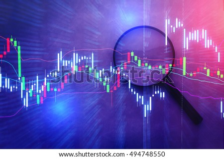 MAGNIFYing glass with business GRAPH CHART ANALYSIS ON GREY BACKGROUND BUSINESS CONCEPT