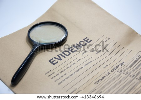 magnifying glass with evidence brown paper bag - stock photo