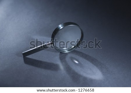 magnifying glass with shadow - stock photo