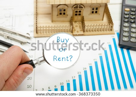 Magnifying glass with  text Buy or Rent in a concept image - stock photo