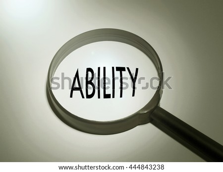 Magnifying glass with the word ability. Searching ability - stock photo