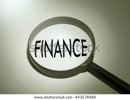 Magnifying glass with the word finance. Searching finance