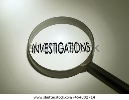Magnifying glass with the word investigations - stock photo