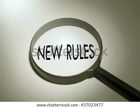 Magnifying glass with the word new rules. Searching new rules