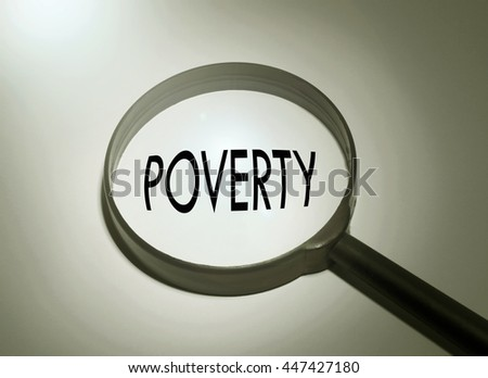 Magnifying glass with the word poverty. selective focus - stock photo