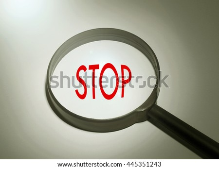 Magnifying glass with the word stop. Searching stop
