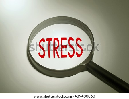 Magnifying glass with the word stress. Searching stress