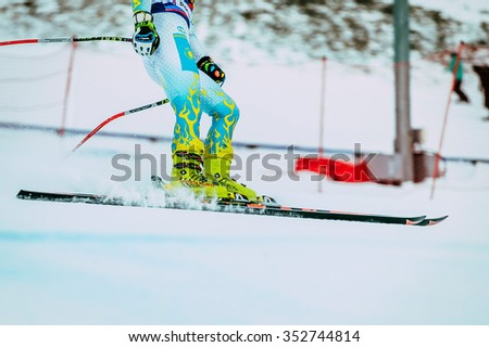 Magnitogorsk, Russia -  December 13, 2015: closeup feet young girl skier after finish spray of snow during Russian Cup in alpine skiing - stock photo