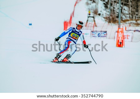 Magnitogorsk, Russia -  December 13, 2015: young athlete male skier after finish of race downhill from mountains during Russian Cup in alpine skiing - stock photo