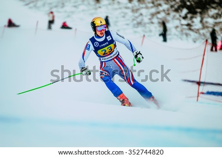 Magnitogorsk, Russia -  December 13, 2015: young girl skier after finish spray of snow during Russian Cup in alpine skiing - stock photo