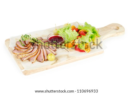 magre smoked duck with cranberry sauce and fruits