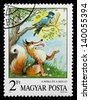 MAGYAR - CIRCA 1987: stamp printed by Magyar, shows the Fox and the crow with cheese, circa 1987 - stock photo