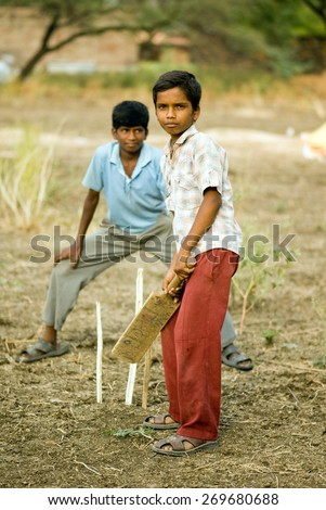 MAHARASHTRA, INDIA - April 23, 2011: Rural village boys playing cricket Salunkwadi Ambajogai Beed