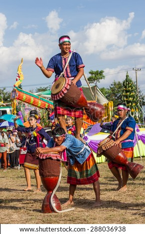 MAHASARAKHAM,THAILAND - MAY 31 : Thai group performing Thai music and Thai dancing  in Rocket festival  on May 31,2015 .This festival for agriculture  to celebration the raining season.