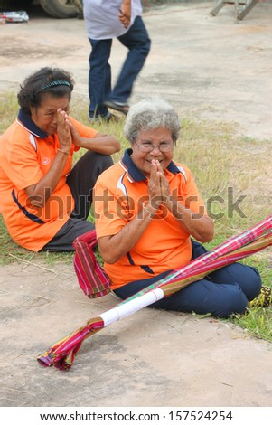 MAHASARAKHAM, THAILAND - OCTOBER 5 : Unidentified old women are preparing to perform wooden staff dance in healthy festival on October 5, 2012 in Kerng local administration institute, Mahasarakham, Thailand.