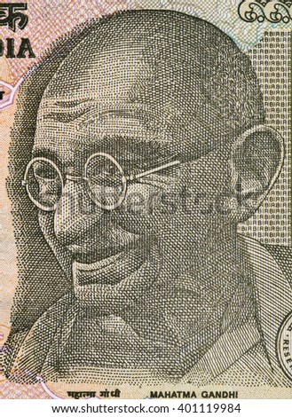 Mahatma Gandhi face on Indian 5 rupee banknote  macro, India money closeup - stock photo